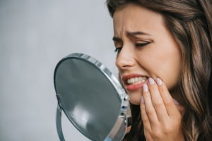 Gum recession can mean exposed teeth roots and painful symptoms.