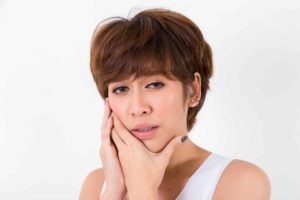 Woman suffering from bruxism